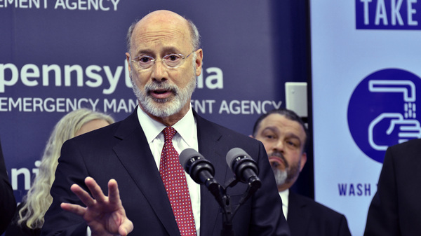 Pennsylvania Gov. Tom Wolf, pictured at a news conference in March, slammed Republicans on Tuesday for celebrating a federal judge