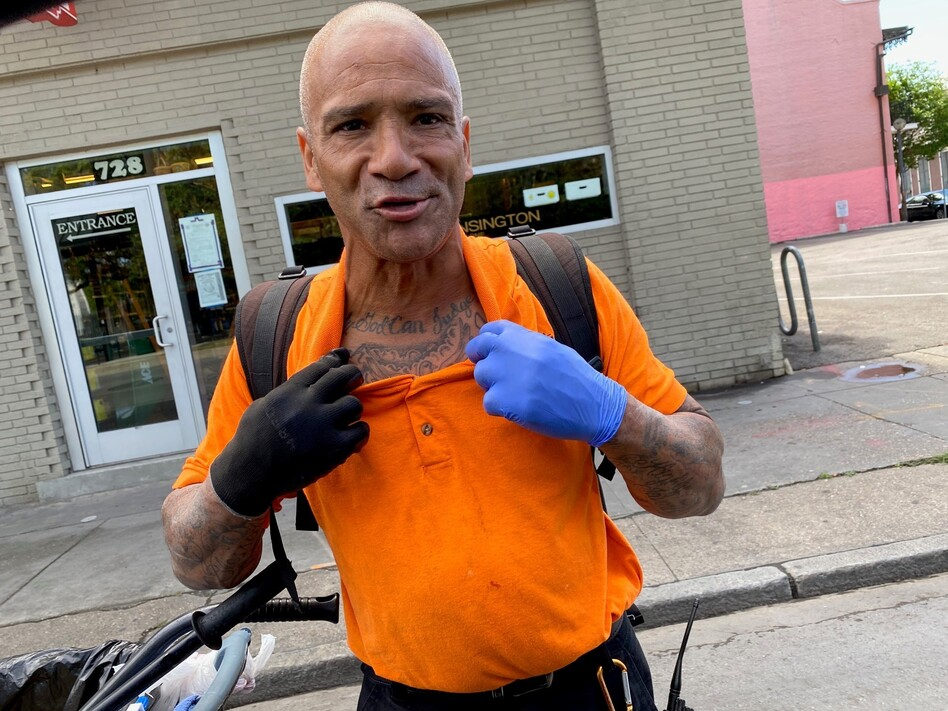 """Bobby Parker, showing off his tattoo that reads """"Only God Can Judge Me,"""" says he had to sleep outside when he was locked out of his New Orleans home. (Katy Reckdahl )"""