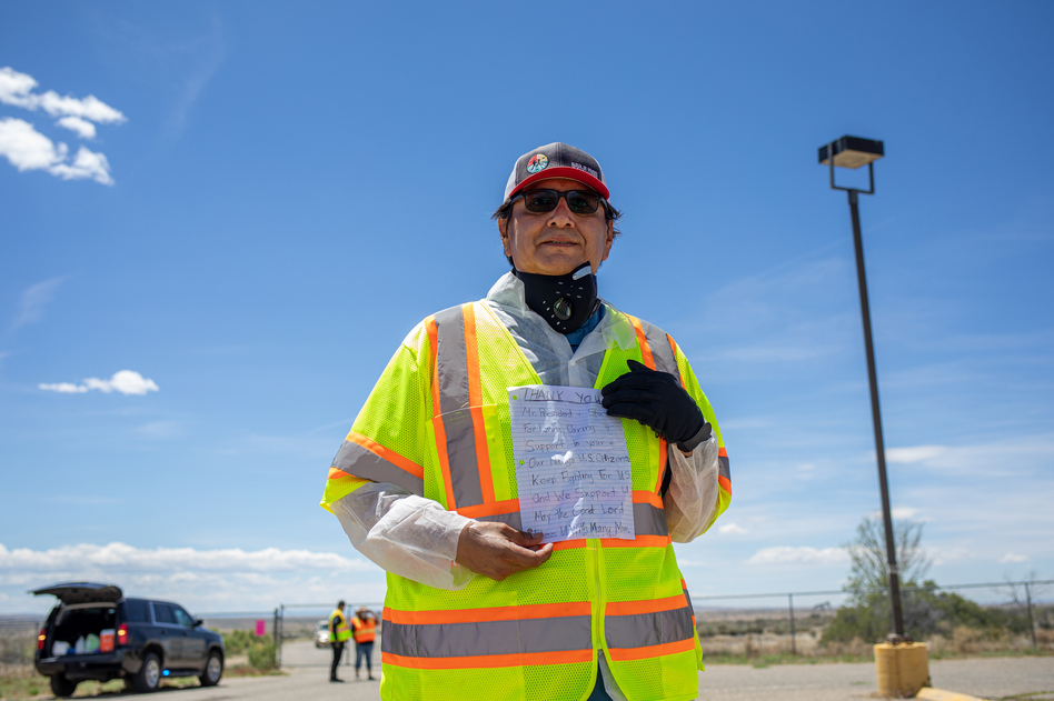 Navajo Nation President Jonathan Nez holds a letter from a Navajo family while distributing food, water and other supplies on May 27, on the Navajo Nation Reservation in New Mexico. (Sharon Chischilly/Getty Images)