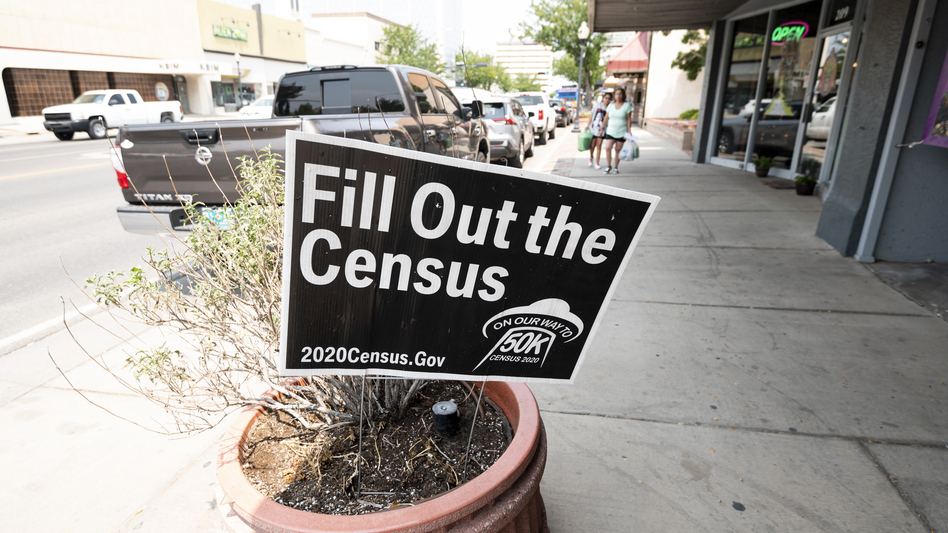 A sign promoting the 2020 census stands in a planter in Roswell, N.M., in August. A federal judge has ordered the Trump administration to continue holding off on wrapping up the census for now. (Bill Clark/CQ Roll Call via Getty Images)