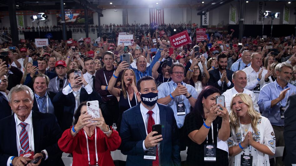 People cheer as President Trump arrives for an indoor campaign rally Sunday night at Xtreme Manufacturing in Henderson, Nev. (Brendan Smialowski/AFP via Getty Images)
