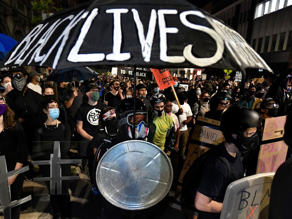 Demonstrators march through the streets of Rochester, N.Y., earlier this month protesting the death of Daniel Prude, apparently stopped breathing as police were restraining him in March. (Adrian Kraus/AP)