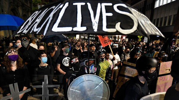 Demonstrators march through the streets in Rochester, N.Y., Friday, Sept. 4, protesting the death of Daniel Prude. Prude apparently stopped breathing as police in Rochester were restraining him in March 2020 and died when he was taken off life support a week later.