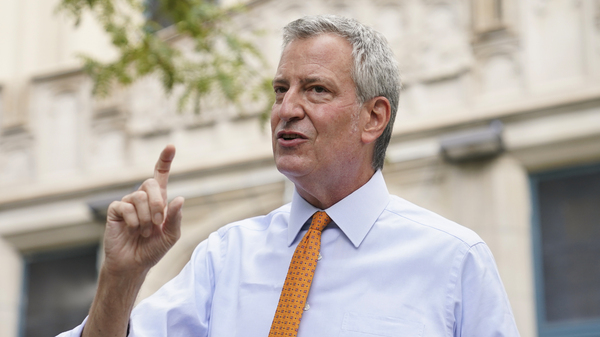 New York Mayor Bill de Blasio, shown here last month in Brooklyn, says that he and employees in his office will take furloughs to reduce costs.