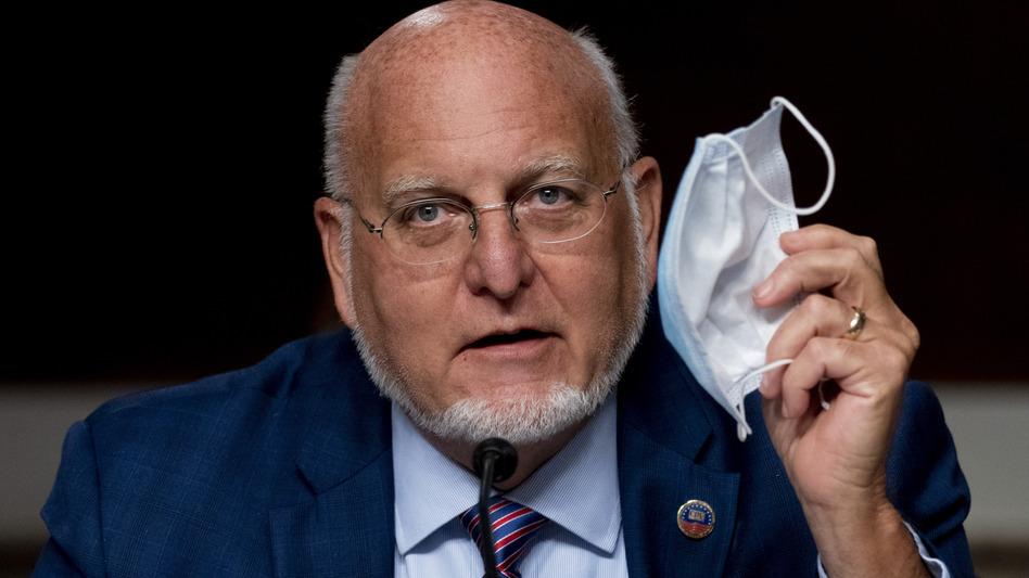 CDC Director Robert Redfield says wearing a mask may provide better protection against COVID-19 than a vaccine. (Andrew Harnik/AP)