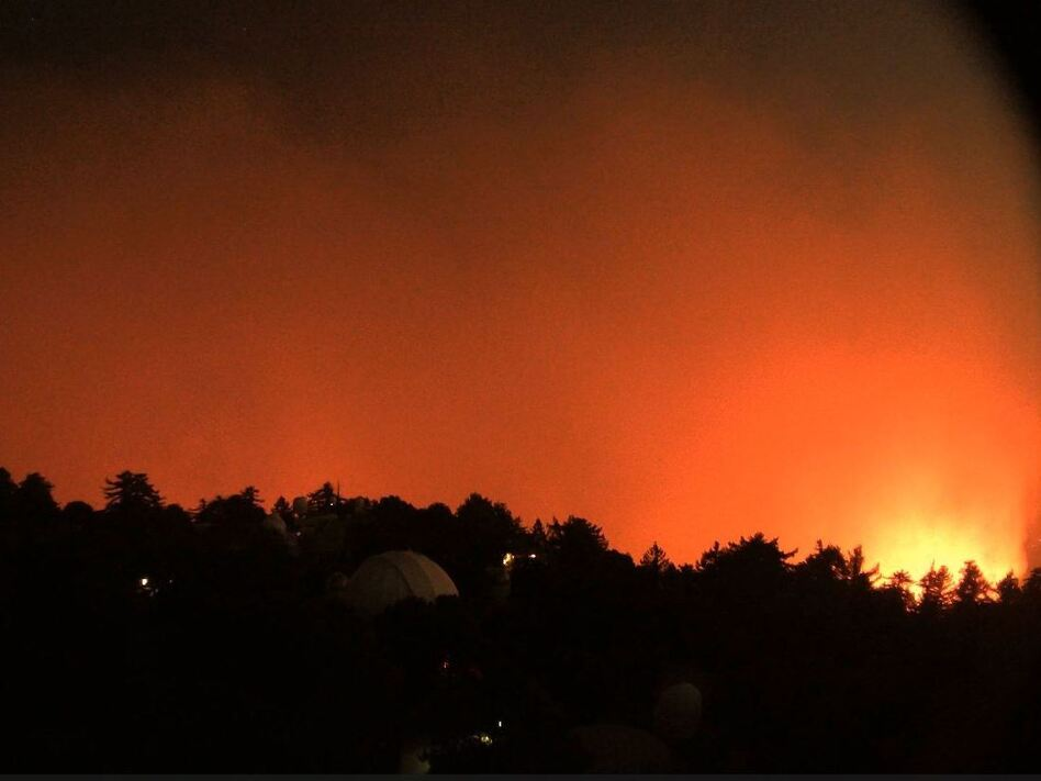 A view facing east from the Mount Wilson Observatory near Los Angeles shows the nearby flames of the Bobcat Fire early Wednesday. (Screenshot by NPR/HPWREN)