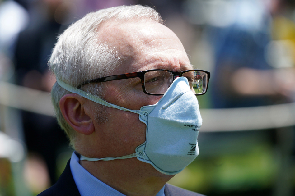 Michael Caputo, pictured at a White House event, is taking a 60-day leave of absence from his job as lead spokesperson for the Department of Health and Human Services after alleging President Trump's opponents have interfered in the coronavirus response. (Kevin Lamarque/Reuters)