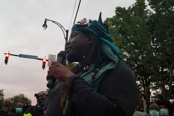 Poet and activist Christopher Coles addresses a crowd in Rochester, N.Y.