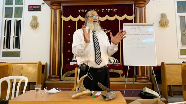 Rabbi Yehonatan Adouar teaches a shofar blowing course in Rambam Synagogue in Ramat Gan, Israel
