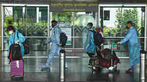 Coronavirus FAQ: I See People Wearing Disposable Coveralls On Planes. Good Idea?