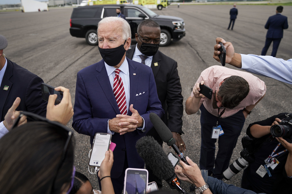 Democratic presidential nominee Joe Biden speaks to reporters before boarding his plane in Florida on Tuesday. Biden leads by 9 points against President Trump, who continues to face an uphill reelection battle. (Drew Angerer/Getty Images)