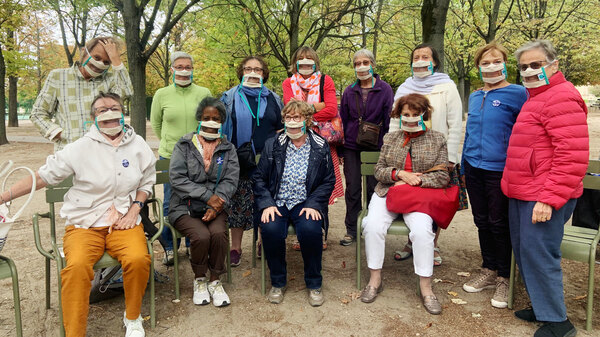 Suzy Margueron (seated, center) who advocates for people with hearing loss, likes to gather with friends in Paris