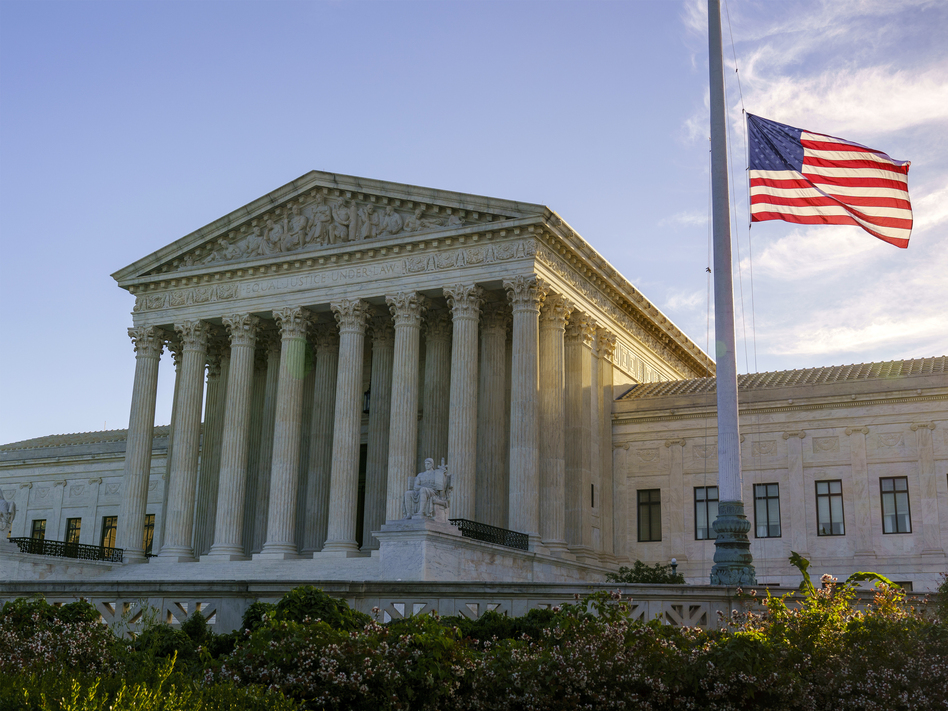 The flag flies at half-staff Saturday at the Supreme Court on the morning after the death of Justice Ruth Bader Ginsburg. (J. Scott Applewhite/AP)