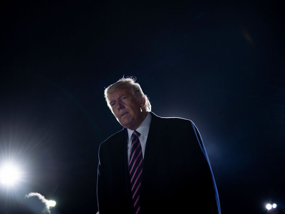 President Trump reacts to the news of the death of Supreme Court Justice Ruth Bader Ginsburg on Friday on the tarmac of Bemidji Regional Airport in Minnesota. (Brendan Smialowski /AFP via Getty Images)