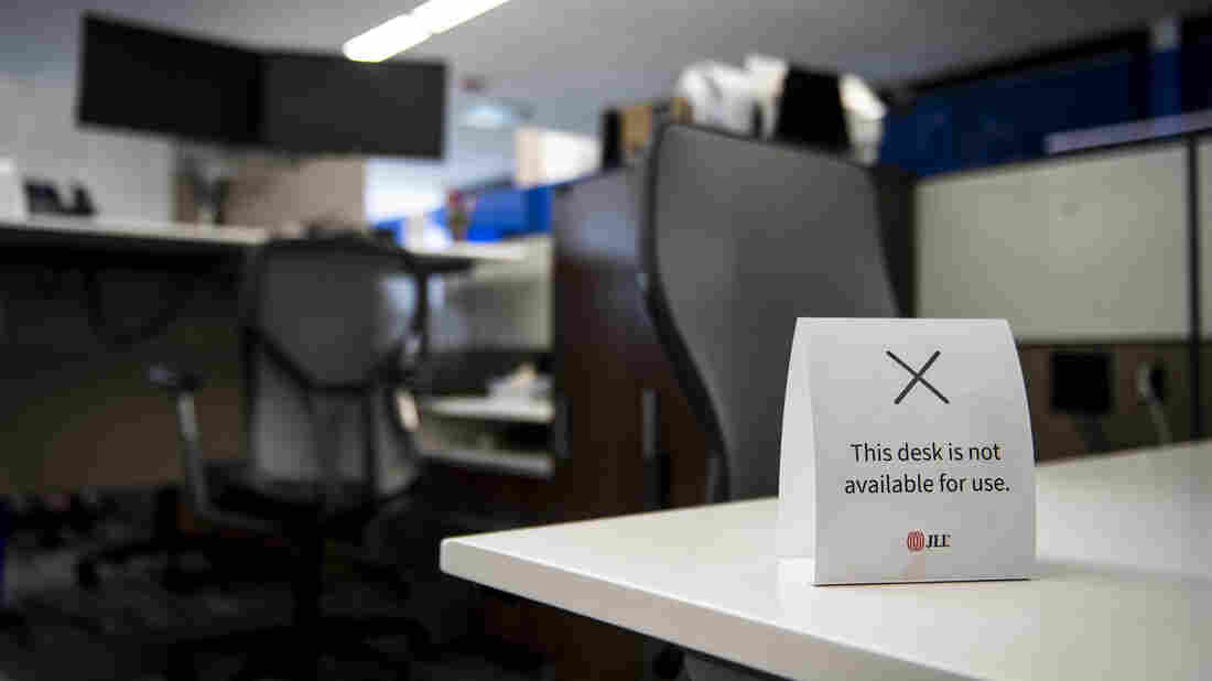 "A sign saying, ""This desk is not available for use"" sits on a desk at the Aon Center in Chicago on June 24."