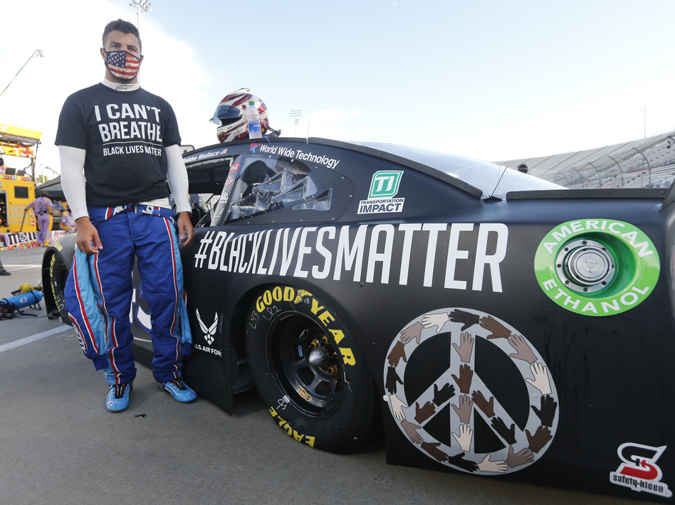 Driver Bubba Wallace waits for the start of a NASCAR Cup Series auto race in June in Martinsville, Va.