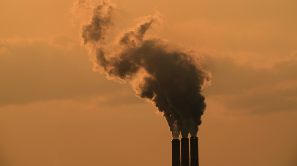 The smokestacks of a coal-fired power plant near Emmet, Kan. in September 2020. Global greenhouse gas emissions continue to rise.