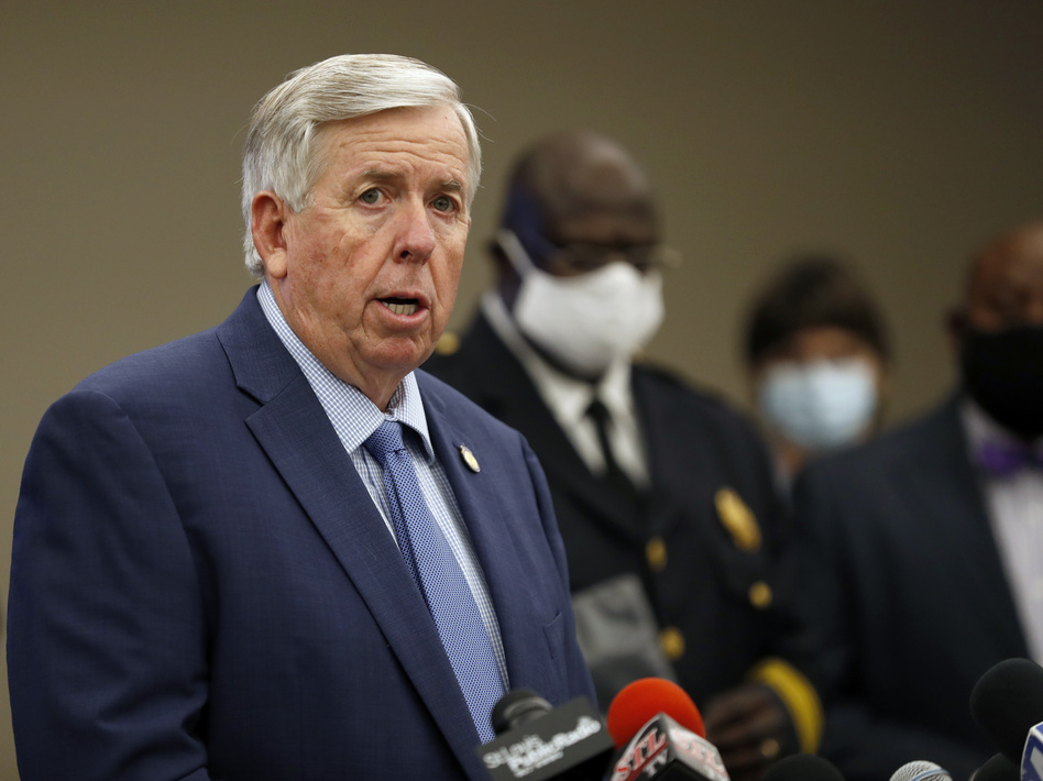 """Missouri Gov. Mike Parson, here at an August news conference in St. Louis, says he and his wife, Teresa Parson, """"are both fine"""" after testing positive for the coronavirus. (Jeff Roberson/AP)"""