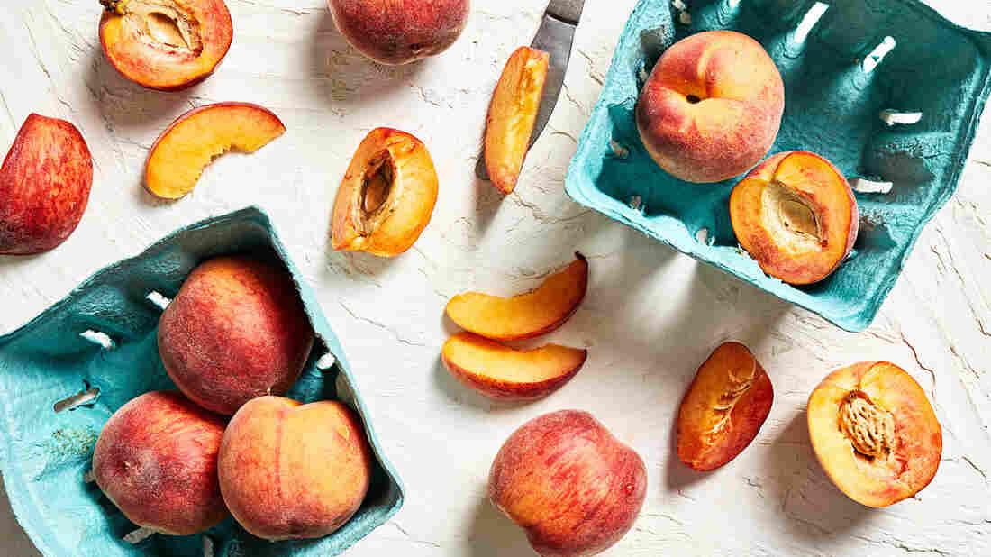 Peaches arranged on a table