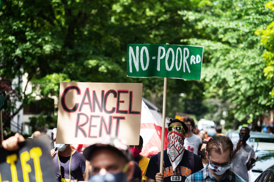 Demonstrators march in Chicago's Old Town neighborhood in June to demand a lifting of the Illinois rent control ban and a cancellation of rent and mortgage payments. The pandemic's financial pressures are causing many Americans to struggle with rent payments. (Max Herman/NurPhoto via Getty Images)