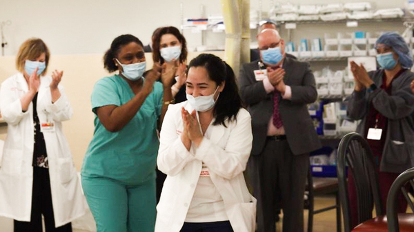 "Nurses clap after Kym Villamer and her colleague Dawn Jones sing ""Ain"