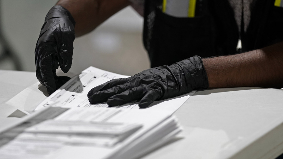 A worker prepares absentee ballots for mailing at the Wake County Board of Elections in Raleigh, N.C., earlier this month. (Gerry Broome/AP)