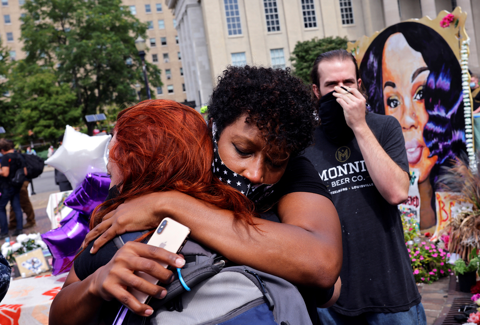 People react Wednesday after the grand jury's decision in the March shooting death of Breonna Taylor by police in her home in Louisville, Ky. (Carlos Barria/Reuters)