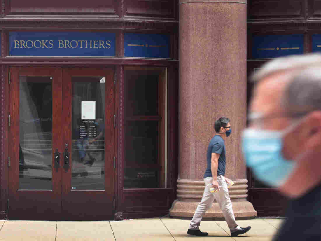 A sign hangs above the entrance of a shuttered Brooks Brothers in Chicago on July 08, 2020, as the company filed for bankruptcy protection.