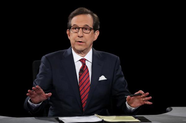 Fox News anchor Chris Wallace, seen here during a presidential debate in 2016, will moderate Tuesday night's debate between Donald Trump and Joe Biden.