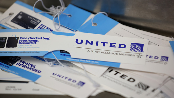 United Airlines baggage tags are displayed on a table at San Francisco International Airport. The carrier says it