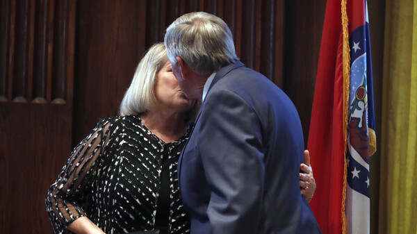 Gov. Mike Parson and his wife, Teresa, share a kiss after he was sworn in as Missouri