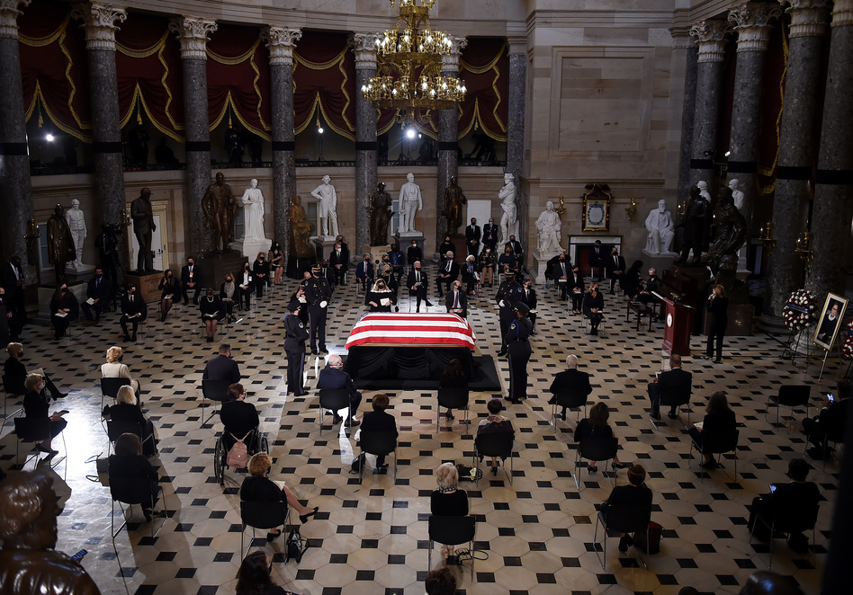 Members of Congress and guests pay their respects to the late Associate Justice Ruth Bader Ginsburg as her casket lies in state during a memorial service in her honor in Statuary Hall of the U.S. Capitol. (Olivier Douliery/Pool/AFP via Getty Images)