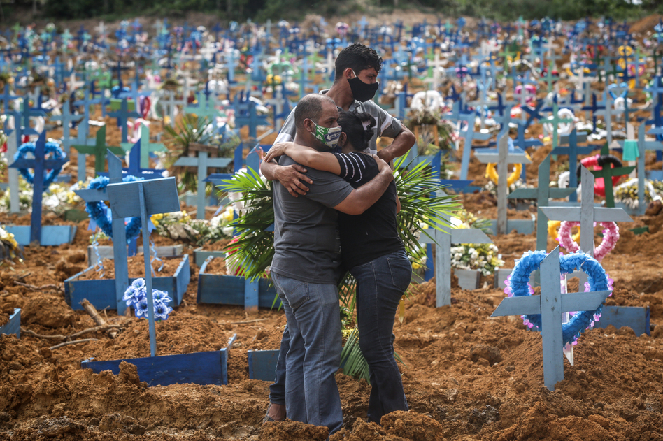 Relatives at a mass burial of pandemic victims at the Parque Taruma cemetery in Manaus, Brazil, mourn a family member. (Andre Coelho/Getty Images)
