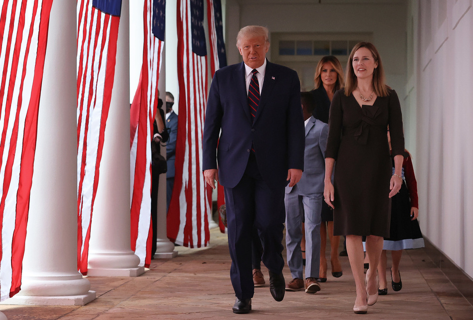 President Trump and Supreme Court nominee Amy Coney Barrett walk along the Rose Garden colonnade on Saturday. The focus on the court just weeks before the election could help energize conservatives in key states. (Chip Somodevilla/Getty Images)