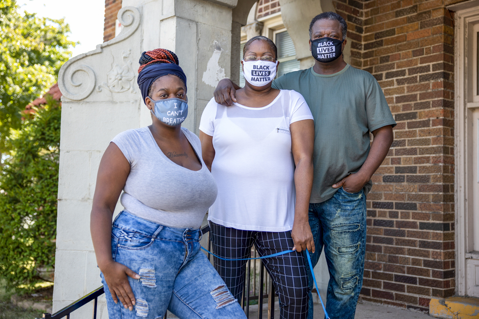 Heavenly Pettigrew, left, and her parents Stephanie and Robert outside their two-bedroom rental apartment in Milwaukee. Without assistance from the nonprofit Community Advocates, the family likely would have faced eviction after the pandemic forced Robert and Heavenly out of their steady jobs. (Coburn Dukehart/Wisconsin Watch)