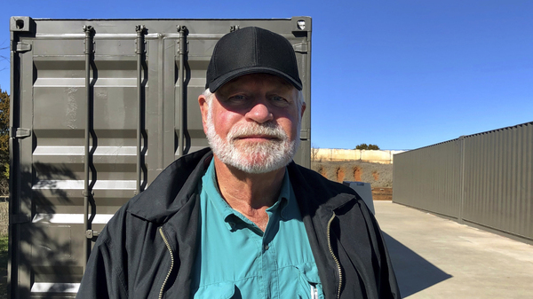 Jack Wilson poses for a photo at a firing range outside his home in Granbury, Texas. Wilson, who trains the volunteer security team of the West Freeway Church of Christ, killed a man who fatally shot two people there on Dec. 29, 2019.