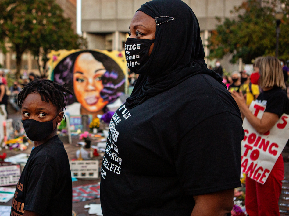 The grand jury recording in the Breonna Taylor case will be released, after a judge ordered the attorney general's office to produce the recording by Wednesday. Here, a mother and son attend a demonstration in what activists are now calling Injustice Square Park in downtown Louisville, as protesters demand justice for Taylor's killing by police. (Jason Armond/Los Angeles Times via Getty Images)