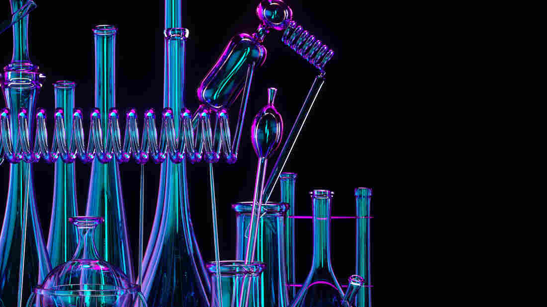 A set of different chemist flasks on black background.