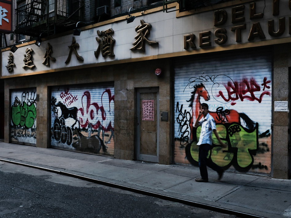A man passes by a closed restaurant in New York City's Chinatown on Aug. 10, 2020. The unemployment rate for Asian Americans has surged amid the pandemic, a trend that has been overlooked amid the widespread economic misery. (Spencer Platt/Getty Images)