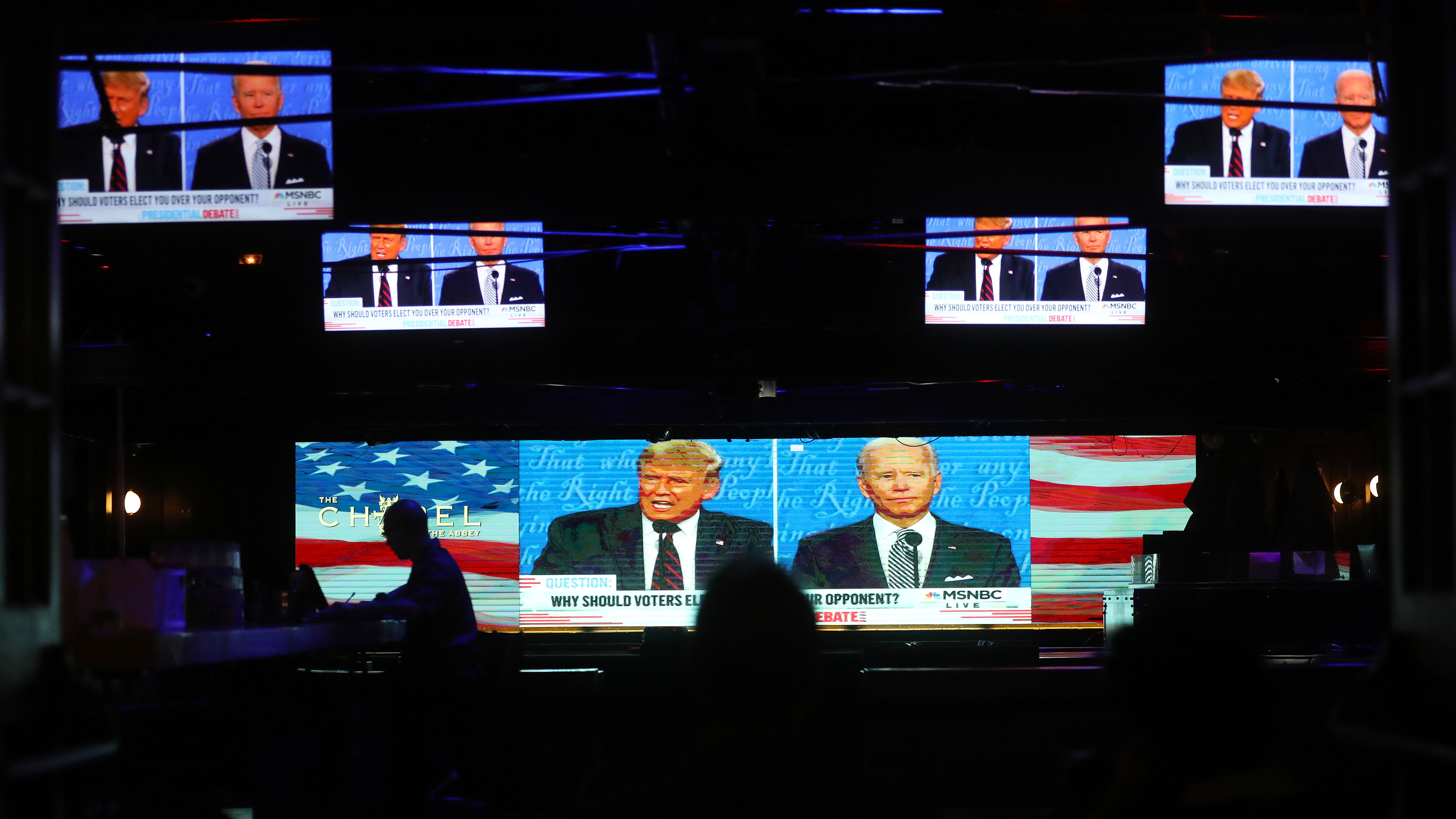 A broadcast of the first debate between President Trump and Democratic nominee Joe Biden is played on TVs at The Abbey in West Hollywood, Calif.