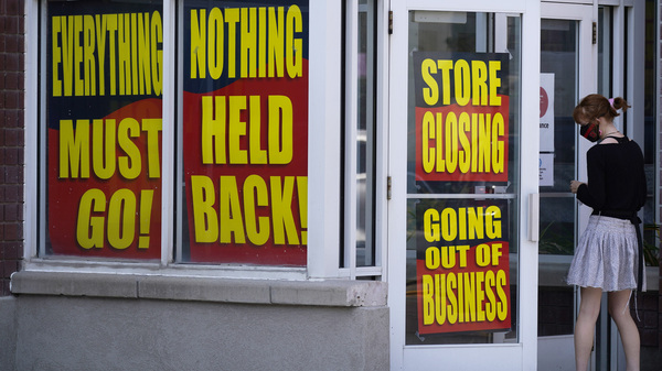 A store announces its looming closure in Salt Lake City on Aug. 30, 2020. An economic recovery is starting to show signs of losing momentum as businesses close and companies announce big layoffs.