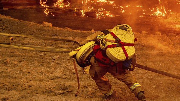 A firefighter battles the Glass Fire in Napa Valley, Calif., on Thursday.