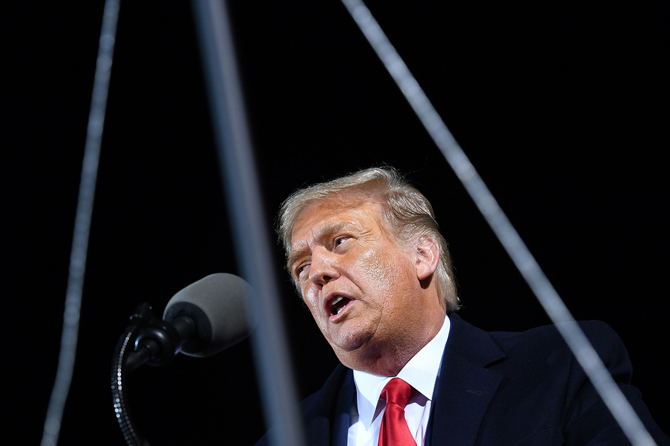 "President Donald Trump speaks Wednesday at a campaign rally at Duluth International Airport in Minnesota. The president, who has tested positive for the coronavirus, ""remains fatigued but in good spirits,"" White House physician Sean Conley said Friday. (Mandel Ngan/AFP via Getty Images)"