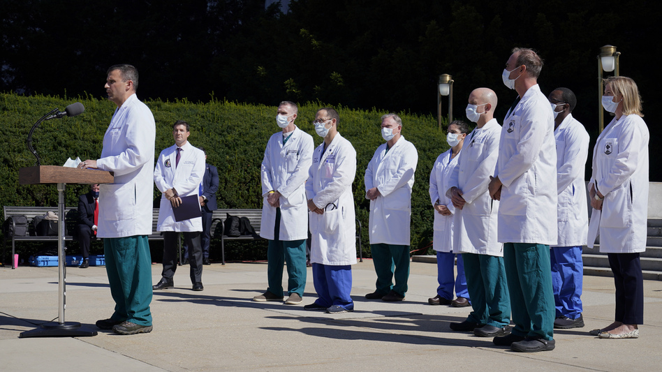 Dr. Sean Dooley briefs reporters at Walter Reed National Military Medical Center in Bethesda, Md. on Saturday. Trump was admitted to the hospital after contracting the coronavirus. (Susan Walsh/AP)