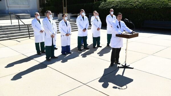 White House physician Dr. Sean Conley gives an update on the condition of President Donald Trump Saturday at Walter Reed Medical Center in Bethesda, Md.