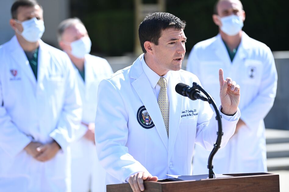 White House physician Sean Conley updates the press on the health status of President Trump on Sunday. (Brendan Smialowski/AFP via Getty Images)