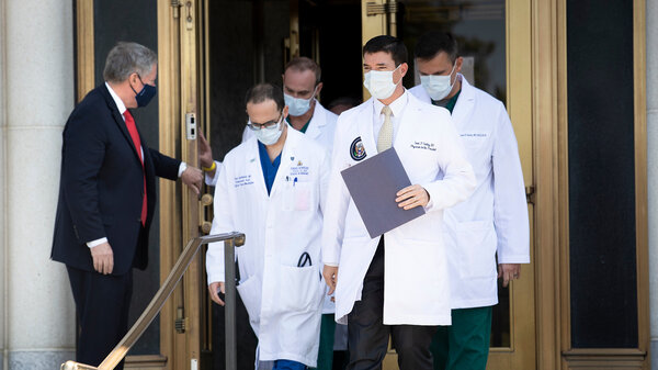 White House chief of staff Mark Meadows holds the door for White House physician Dr. Sean Conley (center) and other members of the president