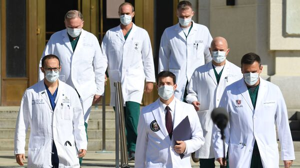 White House physician Sean Conley (center) arrives to answer questions surrounded by other doctors for an update on President Trump