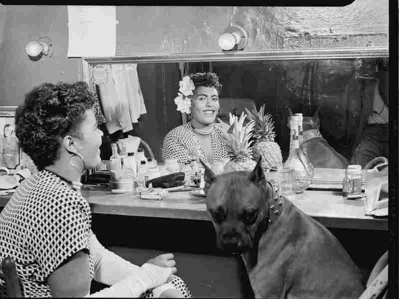 Portrait of Billie Holiday with her pet dog, Mister, at the club Downbeat in New York City.
