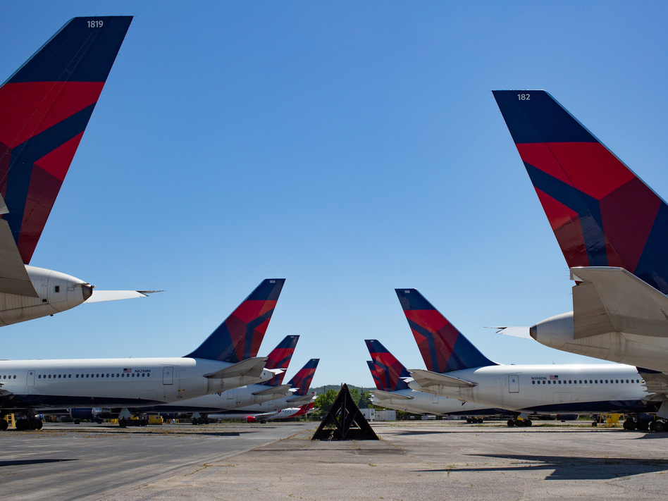 Dozens of Delta jets have been parked on the tarmac of the Birmingham-Shuttlesworth International Airport since last spring. The airline reported $5.4 billion in third quarter losses on Tuesday. (Russell Lewis/NPR)